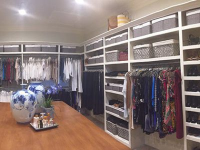 A large closet after having the clothes organized and put away cleanly
